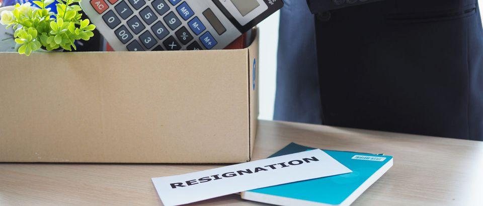 An employee packs up his things. Shutterstock image via best_nj