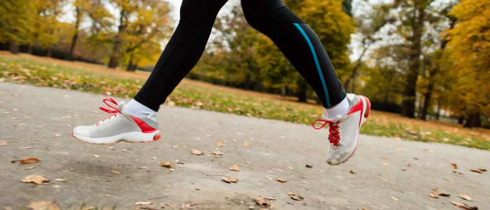 A woman jog. Shutterstock image via user Martin Novak