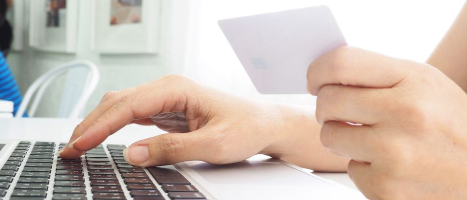 A person is shopping online. Shutterstock image via aoy2518