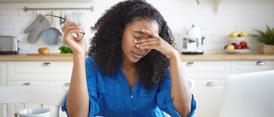 A woman stresses over bills. Shutterstock image via user shurkin_son