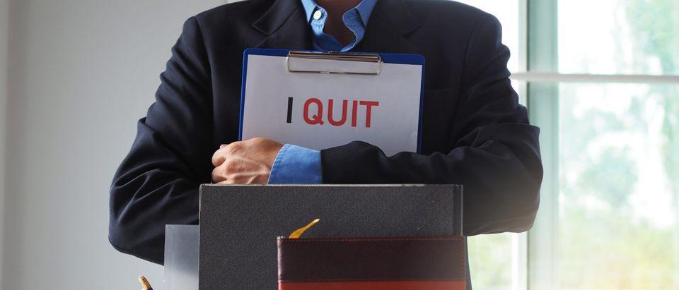 A man tenders his resignation. Shutterstock image via user best_nj