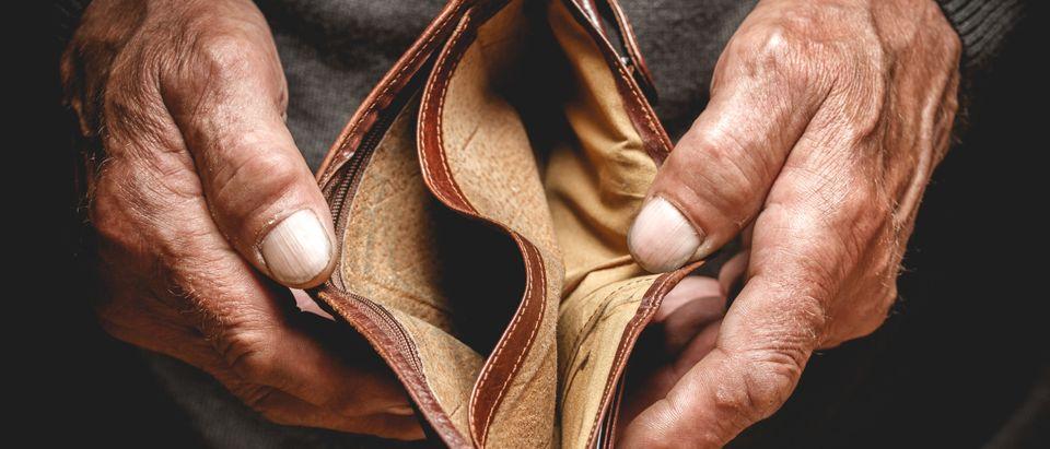 Empty wallet retirement, Shutterstock/ By perfectlab