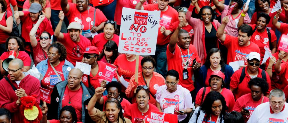 Thousands of Chicago Public School teachers rally before marching to the Board of Education's headquarters in protest in Chicago