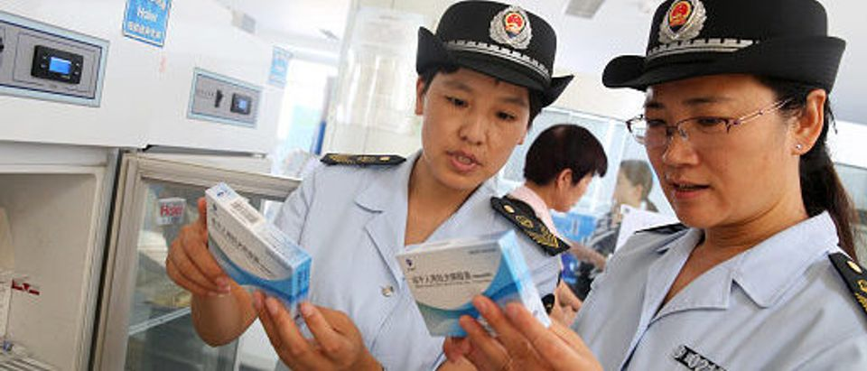 Food and Drug Administration officials check on vaccines for rabies at the Disease Control and Prevention Center in Huaibei in China's eastern Anhui province on July 24, 2018. - Chinese authorities are scrambling to defuse public outrage over a safety scandal involving rabies vaccines, just one of a string of food and drug scares to hit the country in recent years.