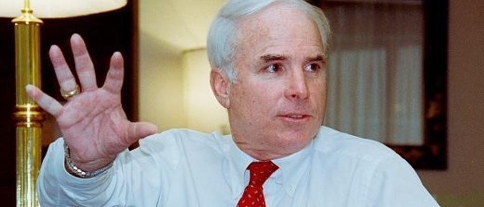 Photo taken on January 9, 1991 in Bangkok shows US Senator John McCain on his way to Vietnam and Cambodia. - MacCain, a former navy pilot who was shot down over Vietnam in 1967 and became a POW in Hanoi, is to meet leaders of both countries.