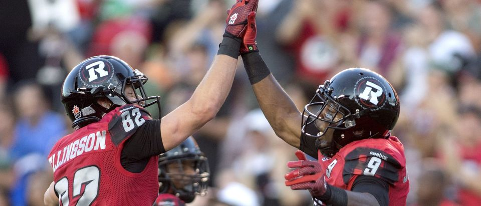 Ottawa RedBlacks' Ernest Jackson celebrates his goal with teammate Greg Ellingson during the first half of their CFL football game in Ottawa