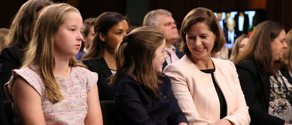 Ashley Estes Kavanaugh, wife of Supreme Court nominee judge Brett Kavanaugh, is seated with their daughters before the start of his Senate Judiciary Committee confirmation hearing on Capitol Hill in Washington, U.S., September 4, 2018. REUTERS/Chris Wattie