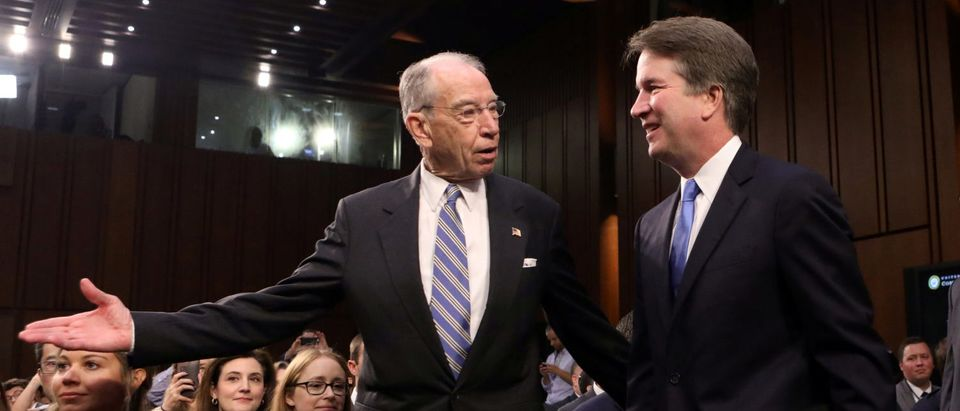 U.S. Supreme Court nominee judge Brett Kavanaugh arrives with Judiciary Committee Chairman Sen. Chuck Grassley (R-IA) for the second day of his confirmation hearing on Capitol Hill in Washington, U.S., September 5, 2018. REUTERS/Chris Wattie