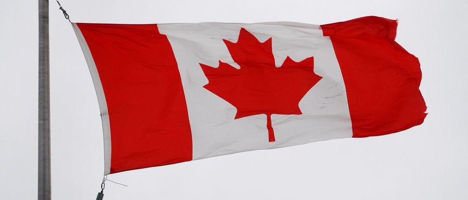 The Canadian flag flutters in the wind in Quebec City