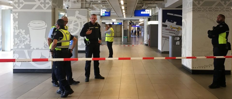 Security officials cordon off an area inside The Central Railway Station in Amsterdam on August 31, 2018, after two people were hurt in a stabbing incident. (Photo by Germain MOYON / AFP) (Photo credit should read GERMAIN MOYON/AFP/Getty Images)