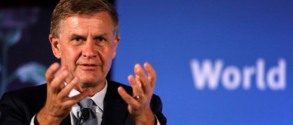 Erik Solheim, Executive Director of the United Nations Environment Program, gestures while addressing the audience at a symposium on World Environment Day in New Delhi