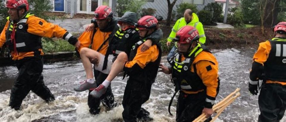 Search and Rescue workers from New York rescue a man from flooding caused by Hurricane Florence in River Bend, North Carolina, U.S. in this September 14, 2018 handout photo. NYC Emergency Management/Handout via REUTERS