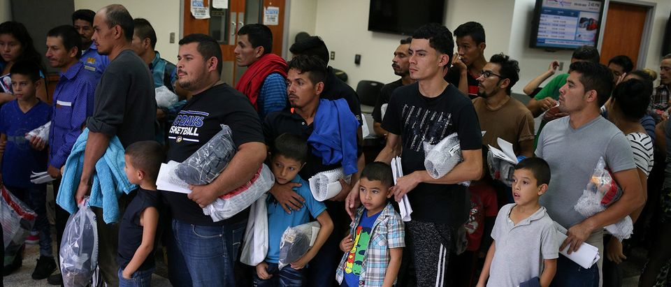 Undocumented immigrant families are released from detention at a bus depot in McAllen, Texas, U.S., July 28, 2018. REUTERS/Loren Elliott