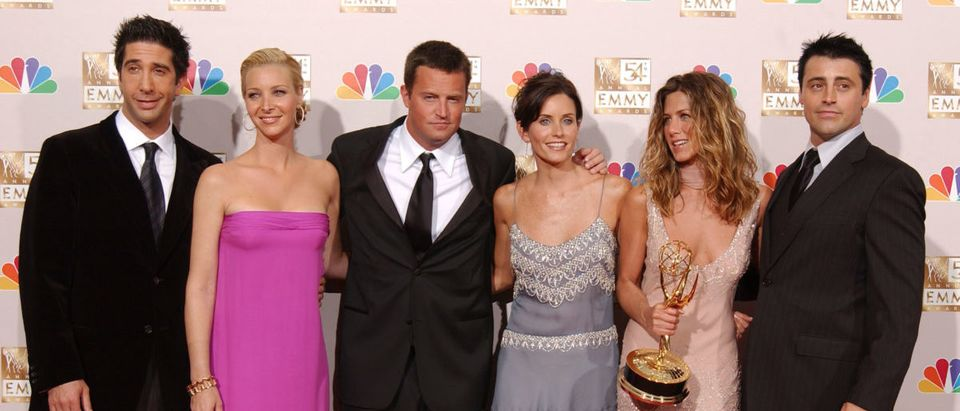 Actors David Schwimmer, Lisa Kudrow, Matthew Perry, Courteney Cox Arquette, Jennifer Aniston and Matt LeBlanc pose backstage during the 54th Annual Primetime Emmy Awards at the Shrine Auditorium on September 22, 2002 in Los Angeles, California. Aniston won Outstanding Lead Actress in a Comedy Series for 'Friends.' (Photo by Robert Mora/Getty Images)