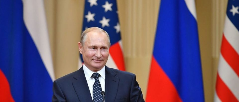 Russia's President Vladimir Putin smiles during a joint press conference with the U.S. president after a meeting at the Presidential Palace in Helsinki, on July 16, 2018. (Photo: YURI KADOBNOV/AFP/Getty Images)