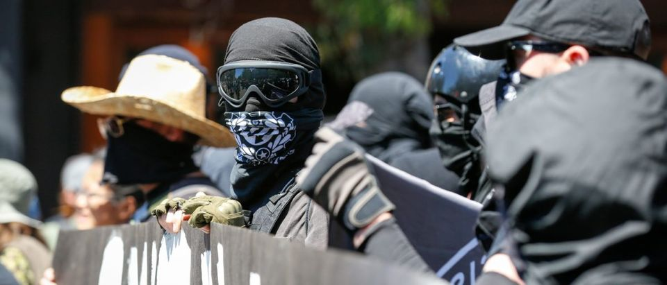 Antifa militants march with counter protesters, as they protest an alt-right rally on August 5, 2018 in downtown Berkeley, California. AMY OSBORNE/AFP/Getty Images
