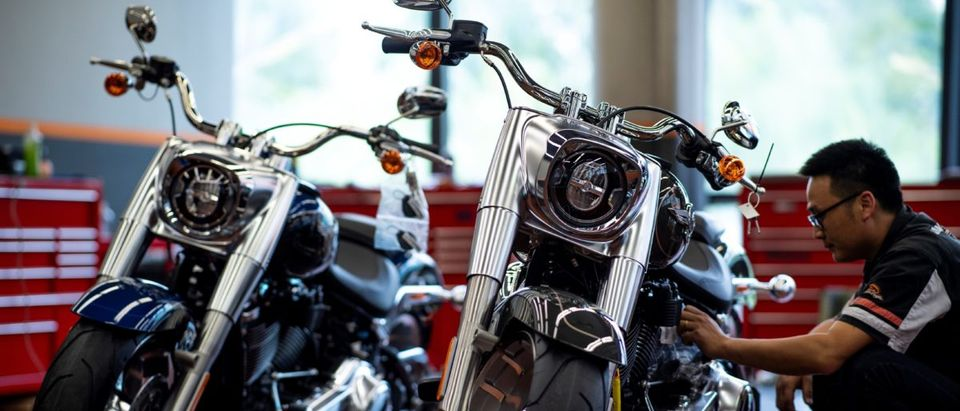 A worker services a Harley-Davidson motorcycle to be sold at a dealership in Shanghai on August 24, 2018. JOHANNES EISELE/AFP/Getty Images