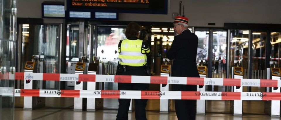 Officials stand inside a cordonned-off area at The Central Railway Station in Amsterdam on August 31, 2018, after two people were injured in a stabbing incident. - Two people were hurt during a stabbing incident at Amsterdam's busy Central Station with the alleged attacker shot and wounded, Dutch police said. (Photo by Remko de Waal / ANP / AFP) / Netherlands OUT (Photo credit should read REMKO DE WAAL/AFP/Getty Images)