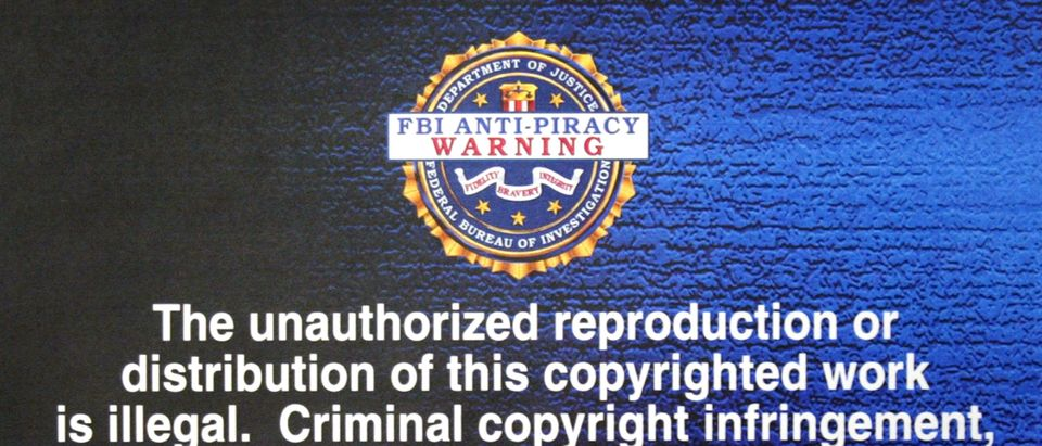 LOS ANGELES, CA- FEBRUARY 19: FBI anti-piracy warning text, to be displayed on digital and software intellectual property, is unveiled at a press conference February 19, 2004 in Los Angeles, California. Representatives of the Recording Industry Association of America and the Motion Picture Association of American also attended the news conference announcing recent measures taken to combat digital piracy. (Photo by David McNew/Getty Images)