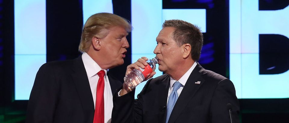 Republican presidential candidates, Donald Trump and Ohio Gov. John Kasich are seen during a broadcast break of the CNN, Salem Media Group, The Washington Times Republican Presidential Primary Debate on the campus of the University of Miami on March 10, 2016 in Coral Gables, Florida. Photo by Joe Raedle/Getty Images