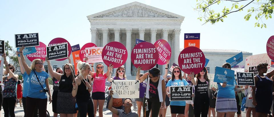 Protesters on both sides of the abortion issue rally in front of the U.S. Supreme Court building June 20, 2016 in Washington, DC. Several groups are waiting for the high court to hand down the Whole Woman's Health v. Hellerstedt ruling before their summer break next week. (Photo by Mark Wilson/Getty Images)