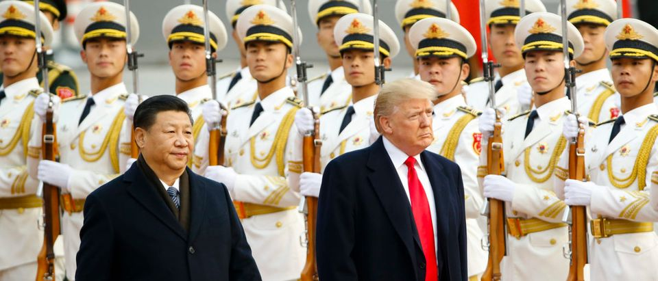 U.S. President Donald Trump takes part in a welcoming ceremony with China's President Xi Jinping on Nov. 9, 2017 in Beijing, China. (Photo by Thomas Peter-Pool/Getty Images)