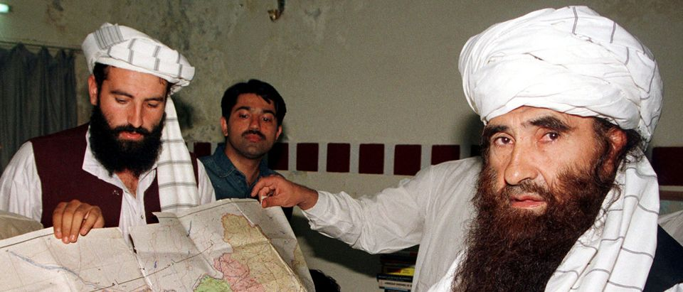 FILE PHOTO - Jalaluddin Haqqani, the Taliban's Minister for Tribal Affairs, points to a map of Afghanistan during a visit to Islamabad, Pakistan