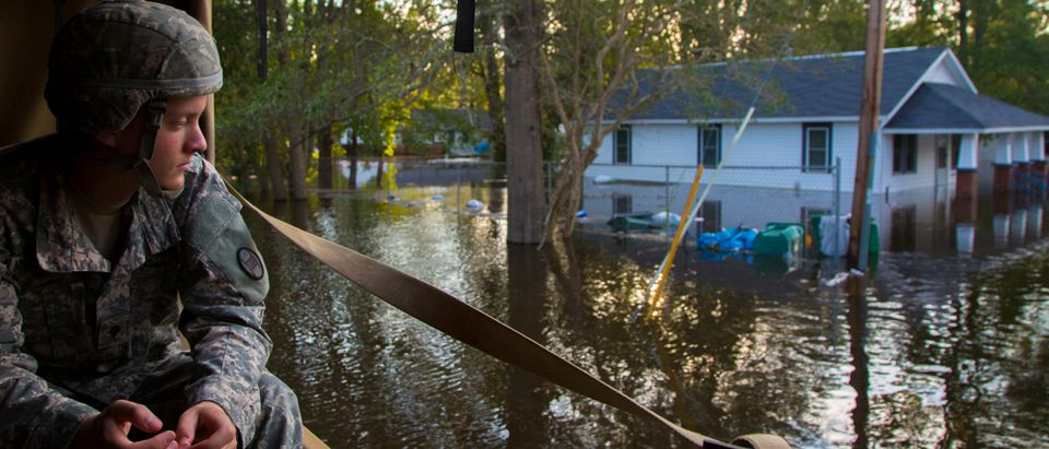 A U.S. Army soldier looks at flooded waters during relief efforts due to Hurricane Florence, now downgraded to a tropical depression, in Lumberton