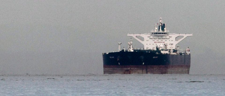 "Malta-flagged Iranian crude oil supertanker ""Delvar"" is seen anchored off Singapore March 1, 2012. Western trade sanctions against Iran are strangling its oil exports even before they go into effect, a U.S. advisory body has found, amid warnings that any shortages will only push up crude prices and strain a weak global economy. REUTERS/Tim Chong"