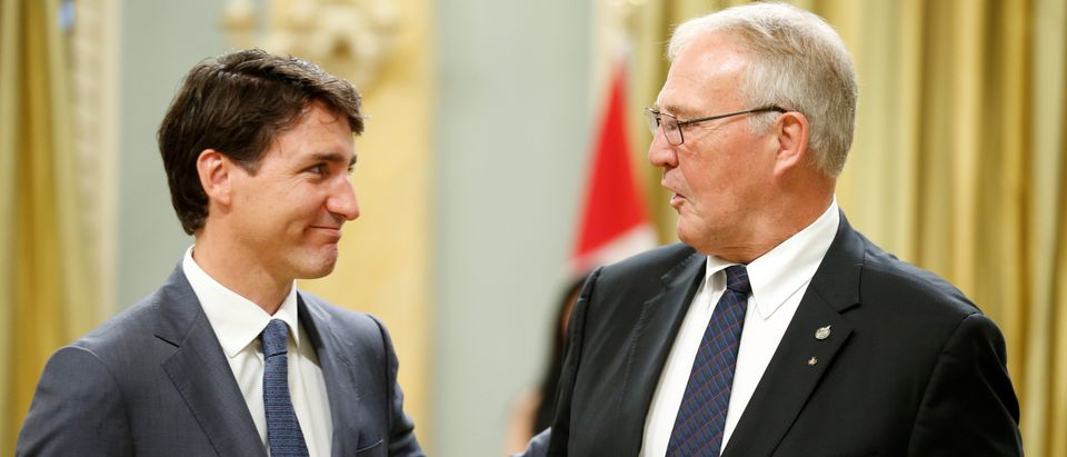 Canada's PM Trudeau congratulates Bill Blair during a cabinet shuffle at Rideau Hall in Ottawa