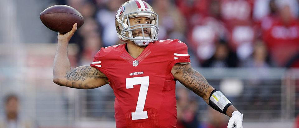 Colin Kaepernick #7 of the San Francisco 49ers in action against the Arizona Cardinals at Levi's Stadium on December 28, 2014 in Santa Clara, California. (Photo by Ezra Shaw/Getty Images)