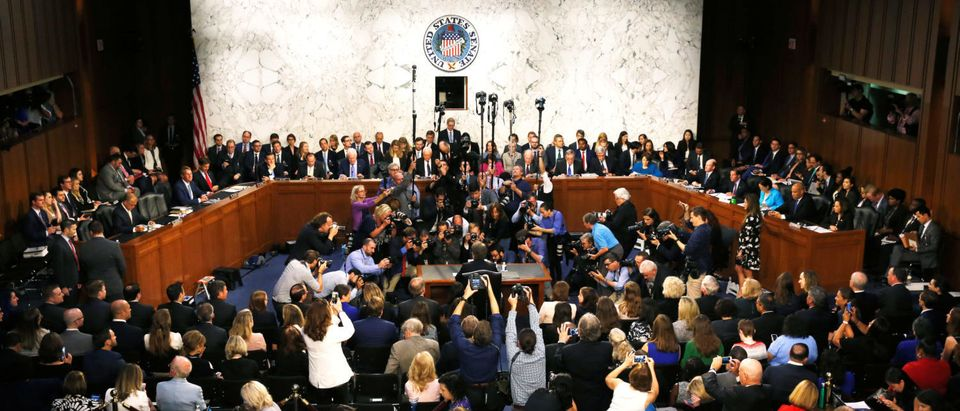 U.S. Supreme Court nominee Judge Kavanaugh is surrounded by photographers at start of Senate confirmation hearing in Washington