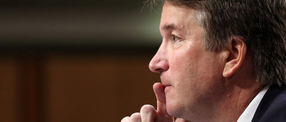 FILE PHOTO: U.S. Supreme Court nominee judge Brett Kavanaugh testifies on Capitol Hill in Washington