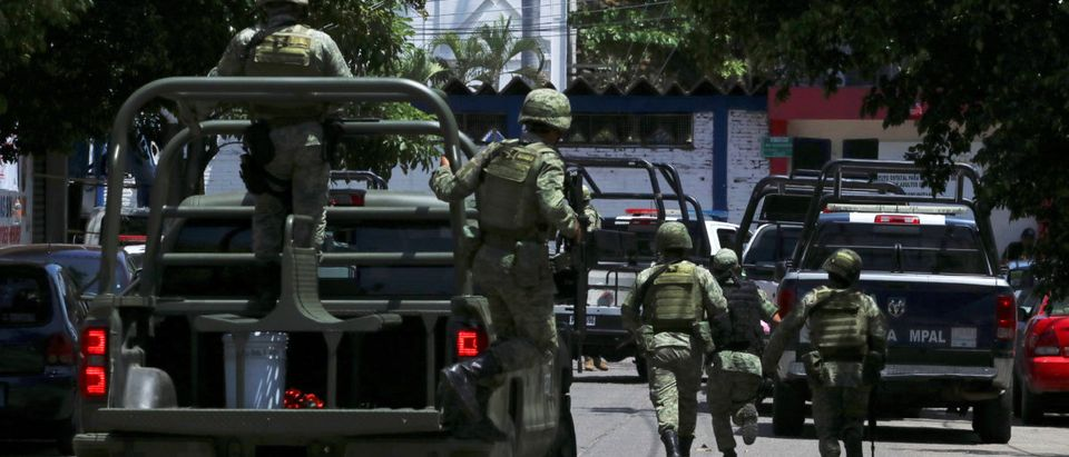 Soldiers arrive to the police headquarters during an operation to check if there are police officers that colluded with organised crime, in Acapulco