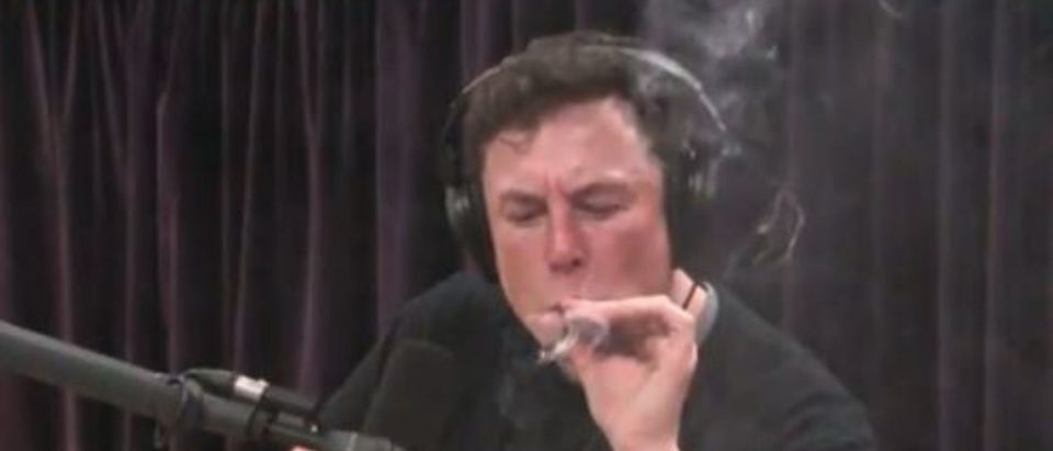 Elon takes a hit off a join during an episode of Joe Rogans podcast YouTube clip)