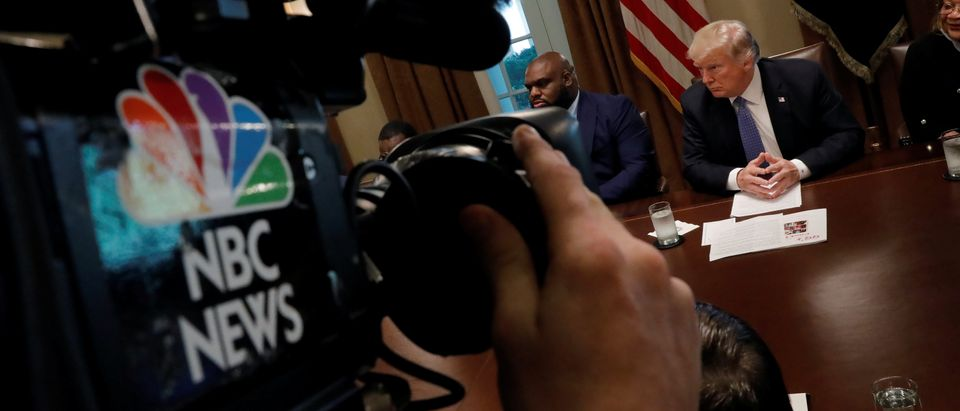 A cameraman films a meeting between U.S. President Donald Trump and inner city pastors meeting with at the Cabinet Room of the White House in Washington D.C.