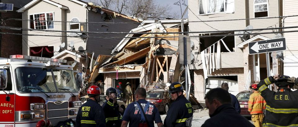 Emergency personnel inspect the site of a building explosion in Elizabeth, New Jersey