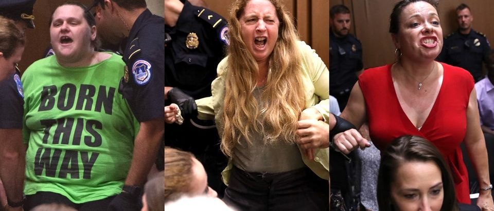 US Capitol Police arrest a protestor as Judge Brett Kavanaugh testifies during the second day of his US Senate Judiciary Committee confirmation hearing to be an Associate Justice on the US Supreme Court, on Capitol Hill in Washington, DC, September 5, 2018. - President Donald Trump's newest Supreme Court nominee Brett Kavanaugh is expected to face punishing questioning from Democrats this week over his endorsement of presidential immunity and his opposition to abortion. (Photo by SAUL LOEB / AFP) (Photo credit should read SAUL LOEB/AFP/Getty Images)