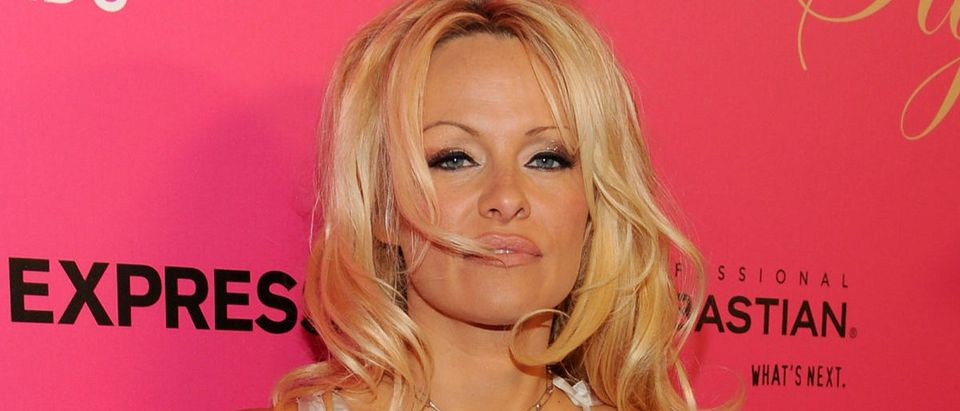 Actress Pamela Anderson arrives for the 6th Annual Hollywood Style Awards at Armand Hammer Museum on October 11, 2009 in Los Angeles, California. (Photo by Kristian Dowling/Getty Images)