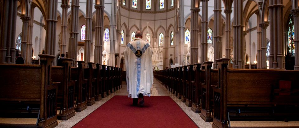 PITTSBURGH, PA - AUGUST 15: Father Kris Stubna walks to the sanctuary following a mass to celebrate the Assumption of the Blessed Virgin Mary at St Paul Cathedral, the mother church of the Pittsburgh Diocese on August 15, 2018 in Pittsburgh, Pennsylvania. The Pittsburgh Diocese was rocked by revelations of abuse by priests the day before on August 14, 2018.(Photo by Jeff Swensen/Getty Images)