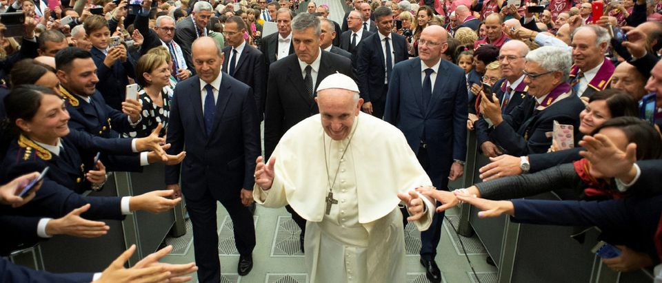 Pope Francis waves as he arrives to lead a special audience with Italian Police members at the Vatican, September 29, 2018. Vatican Media/Handout via REUTERS