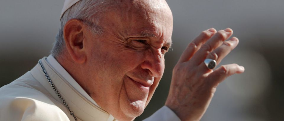 FILE PHOTO: Pope Francis waves as he arrives to lead the Wednesday general audience in Saint Peter's square at the Vatican, August 29, 2018. REUTERS/Alessandro Bianchi/File Photo