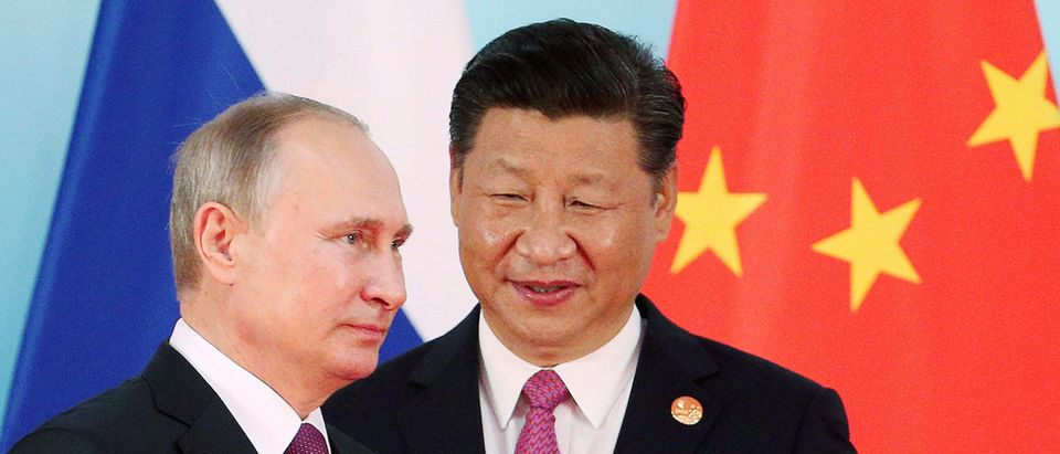Chinese President Xi Jinping (R) stands next to Russian President Vladimir Putin as he arrives for a group photo during the BRICS Summit at the Xiamen International Conference and Exhibition Center in Xiamen, southeastern China's Fujian Province, China September 4, 2017. REUTERS/Wu Hong/Pool