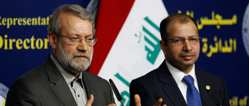 Iran's parliament speaker Ali Larijani (L) and Iraqi parliament speaker Salim al-Jabouri speak during a news conference in Baghdad December 24, 2014. REUTERS/Thaier Al-Sudani (IRAQ - Tags - Tags: POLITICS) - GM1EACO1HVU01