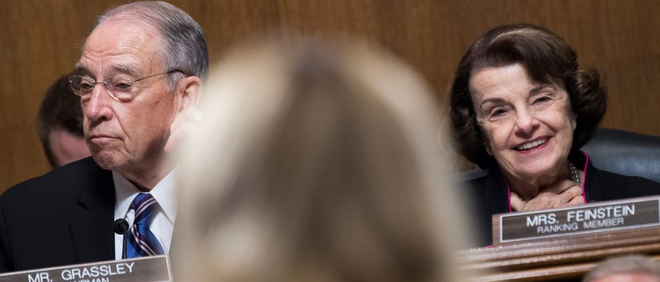 Chairman Charles Grassley, R-Iowa, and ranking member Sen. Dianne Feinstein, D-Calif., listen to Dr. Christine Blasey Ford testify during the Senate Judiciary Committee hearing on the nomination of Brett M. Kavanaugh