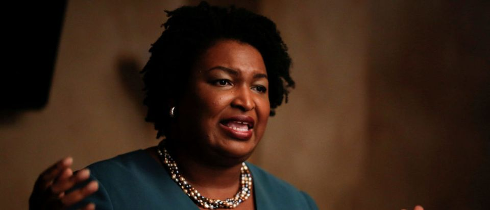 FILE PHOTO: Stacey Abrams speaks at a Young Democrats of Cobb County meeting as she campaigns in Cobb County