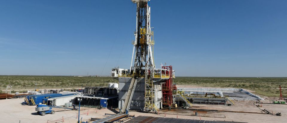 A drilling rig on a lease owned by Oasis Petroleum operates in the Permian Basin oil and natural gas production area near Wink