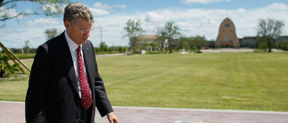 AVA MARIA, FL - SEPTEMBER 27: Tom Monaghan, the multimillionaire founder of Domino's Pizza, walks on the campus of the University of Ava Maria which he founded September 27, 2007 in Ave Maria, Florida. The University and town is being built on a 5,000-acre tract of land that was formally agricultural fields. The town has plans to include 11,000 homes, three golf courses and its own water park, all oriented around a towering church. (Photo by Joe Raedle/Getty Images)