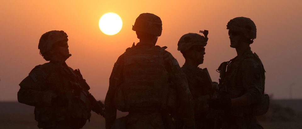 FILE PHOTO: American soldiers are seen at the U.S. army base in Qayyara, south of Mosul