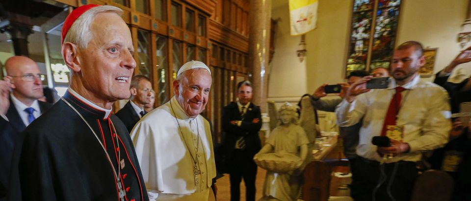 WASHINGTON, DC - SEPTEMBER 24: Pope Francis (R) arrives with Cardinal Donald Wuerl (L) to visit St. Patrick in the City Catholic church on September 24, 2015 in Washington, DC. St. Patrick is the oldest Catholic church in Washington, founded in 1794. Pope Francis is on a five-day trip to the USA, which includes stops in Washington DC, New York and Philadelphia, after a three-day stay in Cuba. (Photo by Erik S. Lesser-Pool/Getty Images)